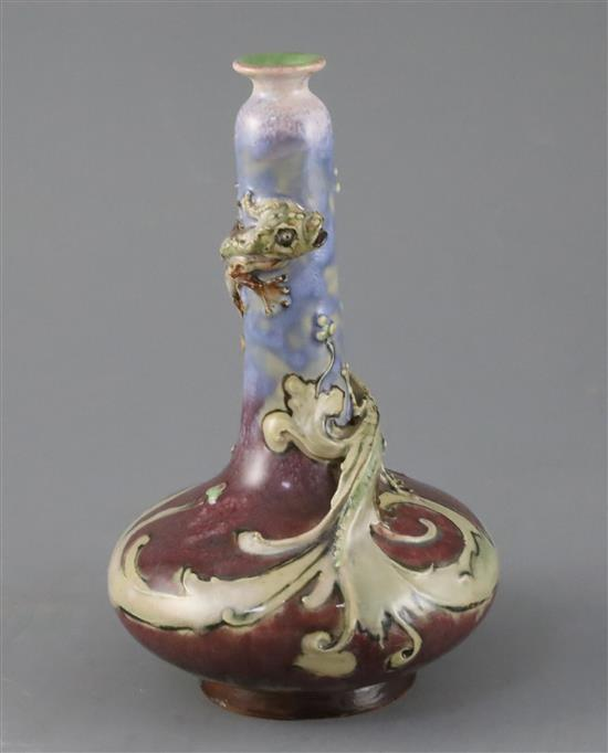 Mark V Marshall for Doulton lambeth, a flambe bottle vase entwined by a mythical beast