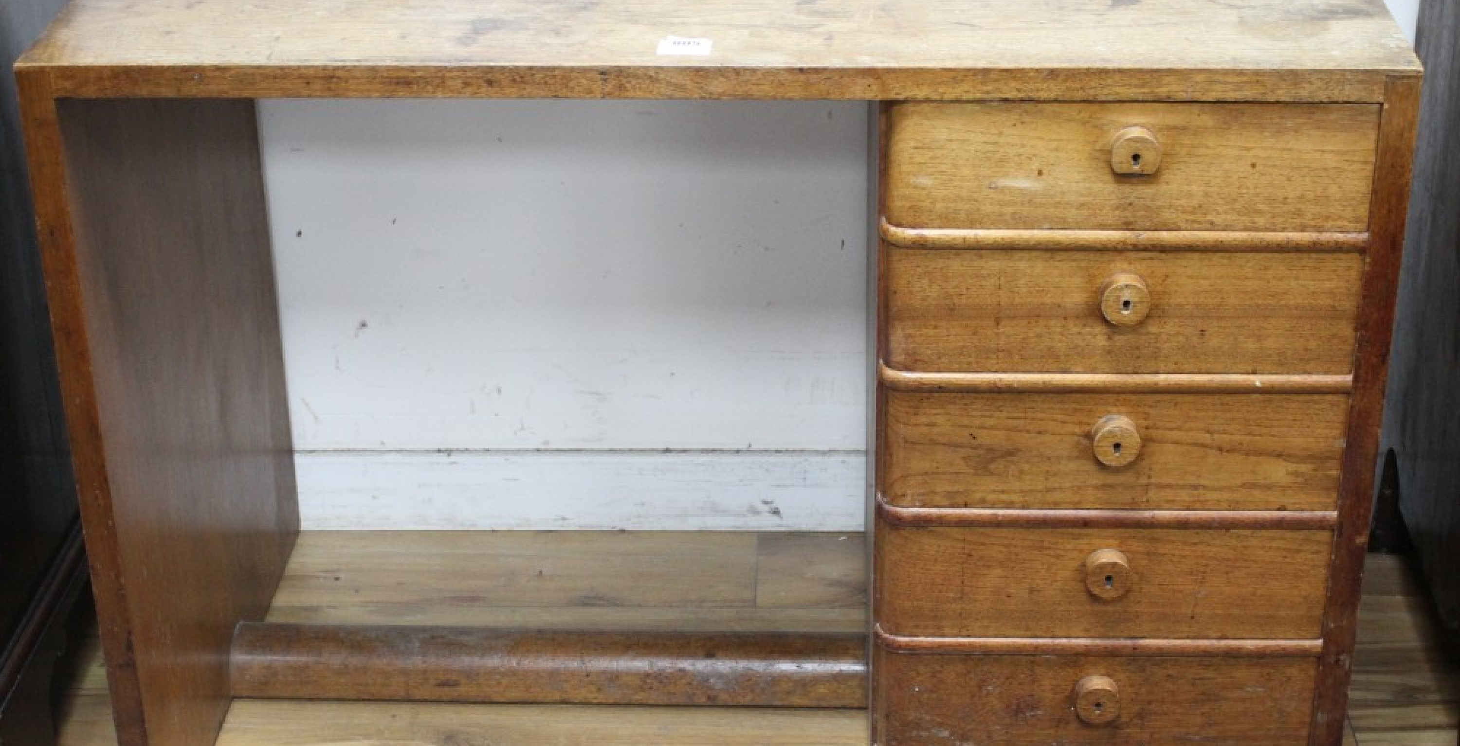 Gordon Russell teak desk with five drawers